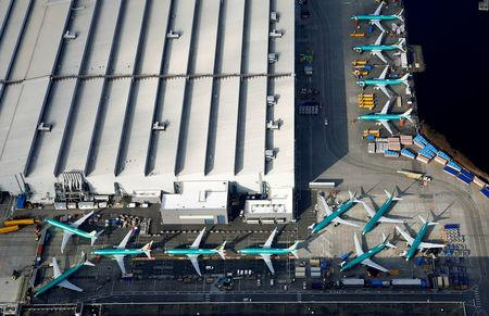 FILE PHOTO: An aerial photo shows Boeing 737 MAX airplanes parked on the tarmac at the Boeing Factory in Renton