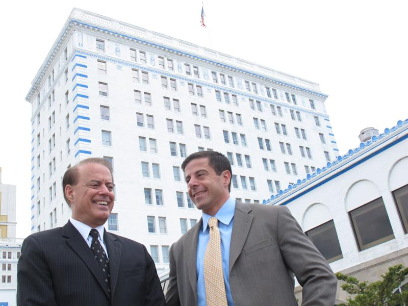 Dennis Gomes, left, a co-owner of Resorts Casino Hotel, and his son Aaron, a vice president at the casino, after Resorts was granted a permanent casino license by the New Jersey Casino Control Commission, Wednesday,  July 13, 2011, in Atlantic City. The New Jersey Casino Control Commission granted the license to Resorts and its co-owners, Dennis Gomes, a former Nevada casino regulator credited with helping drive the mob out of Las Vegas, and Morris Bailey, a deep-pocketed New York real estate investor.(AP Photo/Wayne Parry)