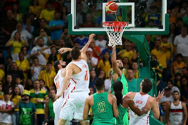 """<a class=""""link rapid-noclick-resp"""" href=""""/olympics/rio-2016/a/1178389/"""" data-ylk=""""slk:Marcus Vinicius Marquinhos"""">Marcus Vinicius Marquinhos</a> of Brazil scores the winning basket against Spain on Day 4 of the Rio 2016 Olympic Games. (Alex Livesey/Getty Images)"""