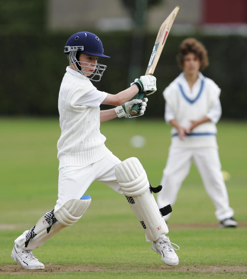 LONDON - AUGUST 14: A young cricketer hits out at The Spencer Club on August 14, 2005 in London. (Photo by Clive Rose/Getty Images)