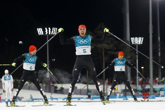 Nordic Combined Events - Pyeongchang 2018 Winter Olympics - Men's Individual 10 km Final - Alpensia Cross-Country Skiing Centre - Pyeongchang, South Korea - February 20, 2018 - Gold medalist, Johannes Rydzek of Germany, silver medalist, Fabian Riessle of Germany and bronze medalist Eric Frenzel of Germany react as they cross the finish line. REUTERS/Kai Pfaffenbach