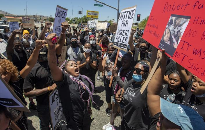 Hundreds of demonstrators gather at the Los Angeles County Sheriff's Department's Palmdale Station