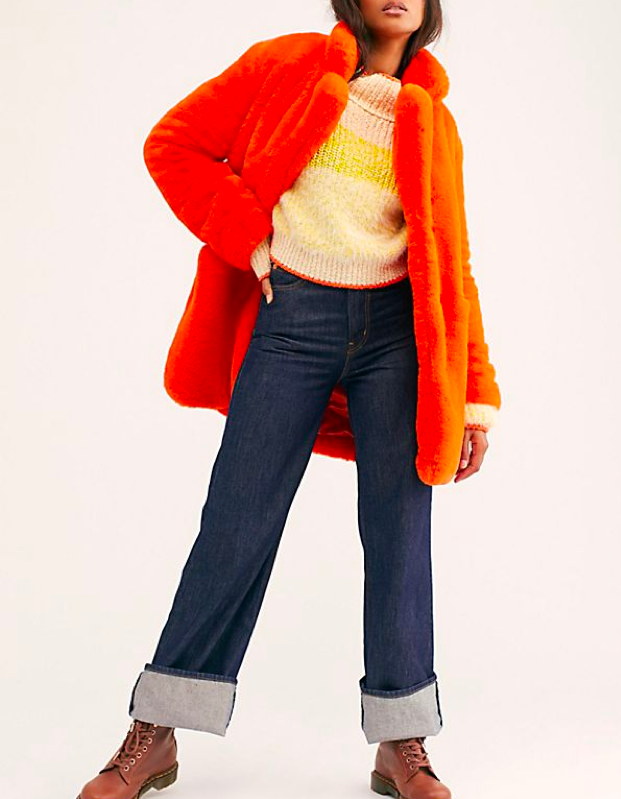 """A lot of teddy coats have large front pockets in an attempt to imitate the I.Am.Gia. favorite, but not this one! Instead this orange faux-fur collared jacket has some more subtle side pockets (not that subtlety would be your thing in this statement piece). $325, Free People. <a href=""""https://www.freepeople.com/shop/sophie-faux-fur-coat/?color=080&quantity=1&type=REGULAR"""" rel=""""nofollow noopener"""" target=""""_blank"""" data-ylk=""""slk:Get it now!"""" class=""""link rapid-noclick-resp"""">Get it now!</a>"""