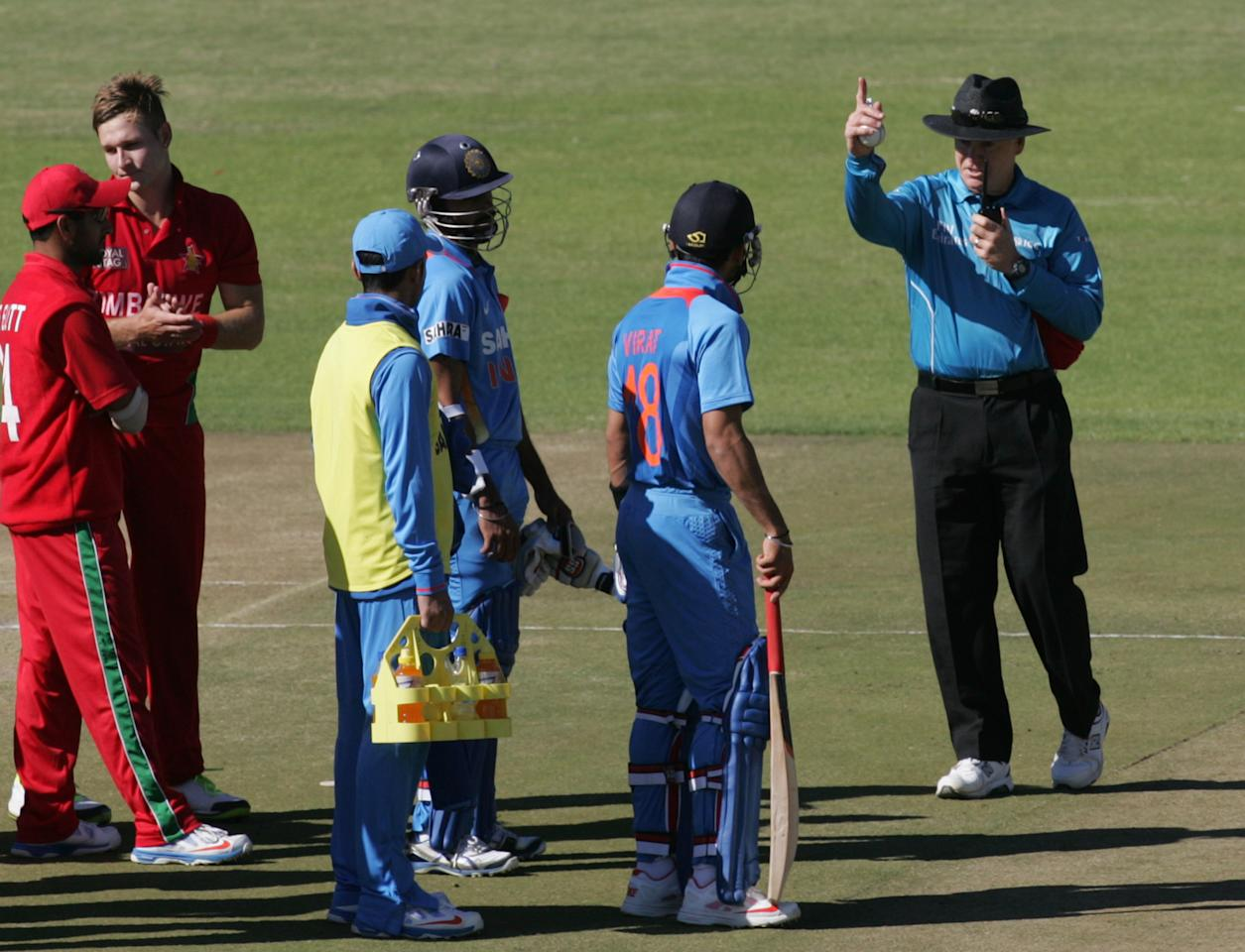 India captain Virat Kohli is given out by umpire Bruce Oxenford after a review during the 2nd match of the 5 match cricket ODI series between hosts Zimbabwe and India at Harare Sports Club on July 26 2013. AFP PHOTO /Jekesai Njikizana.        (Photo credit should read JEKESAI NJIKIZANA/AFP/Getty Images)