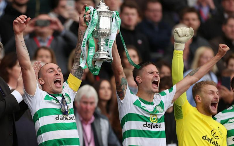 Celtic's Scott Brown and Mikael Lustig lift the Scottish Cup for the third time in a row at Hampden Park - Action Images via Reuters
