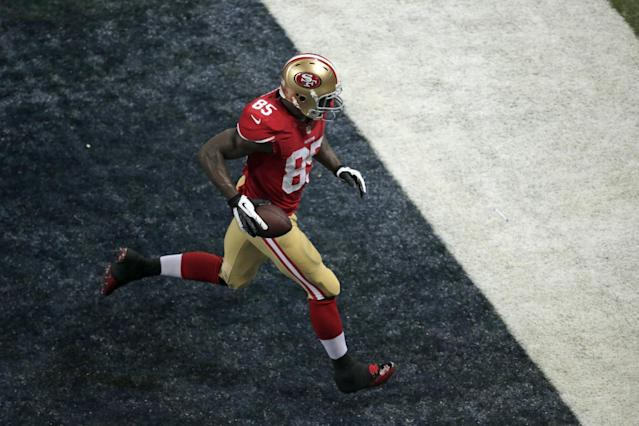 San Francisco 49ers tight end Vernon Davis scores on a 12-yard touchdown reception during the third quarter of an NFL football game against the St. Louis Rams on Thursday, Sept. 26, 2013, in St. Louis. (AP Photo/Charlie Riedel)
