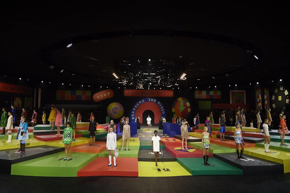 <p>Dior proved that we all need a little bit of color during times like these. Instead of doing a traditional runway show where the models walked down the catwalk, the set was reimagined in a collaboration by the artist Anna Paparatti, who paid tribute to the colorful Roman nightclub The Piper Club, a mainstay for the bright aesthetic revolution of the swinging 1960s in Italy. The platform rotated below disco balls and models stepped off one-by-one to walk the circular runway. With a heavy dose of color and print, guests were spellbound by the kaleidoscopic presentation.</p>