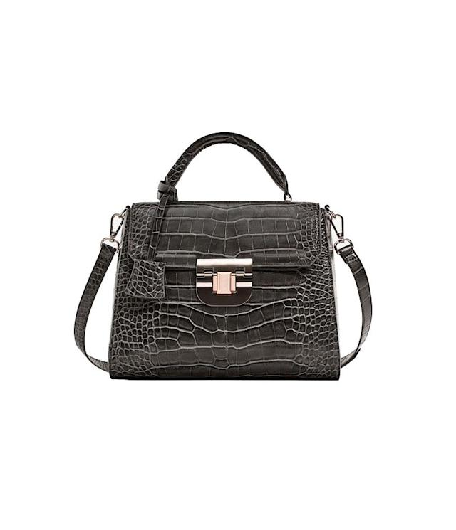 "<p>Embossed City Bag With Fastening Detail, $56, <a href=""https://www.zara.com/us/en/collection-aw-17/woman/bags/embossed-city-bag-with-fastening-detail-c269200p4613049.html"" rel=""nofollow noopener"" target=""_blank"" data-ylk=""slk:Zara.com"" class=""link rapid-noclick-resp"">Zara.com</a> </p>"