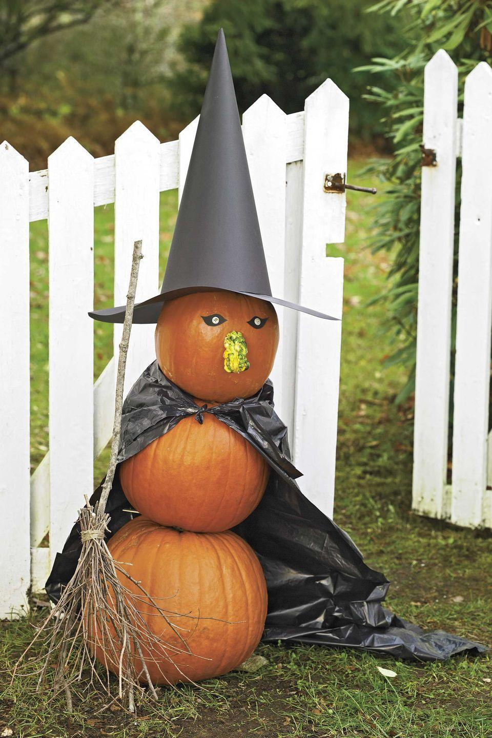 <p>This trio of pumpkins — complete with a mini-gourd nose — is a dead ringer for a spooky witch when topped with a pointy hat and trash bag cape.</p>