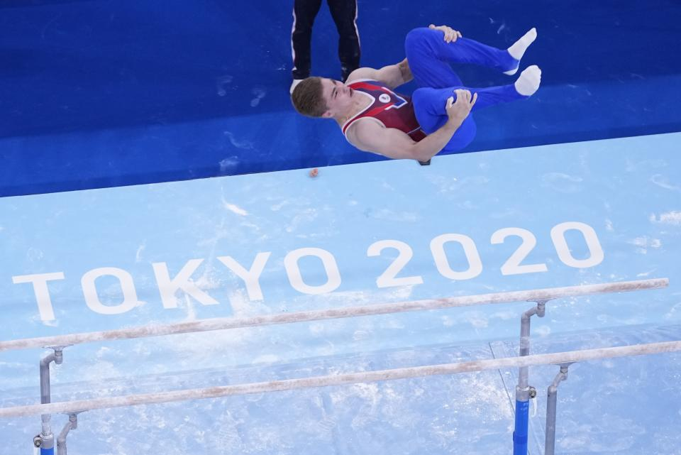 Aleksandr Kartsev, of Russian Olympic Committee, performs on the parallel bars during men's artistic gymnastics qualifications at the 2020 Summer Olympics, Saturday, July 24, 2021, in Tokyo. (AP Photo/Morry Gash)