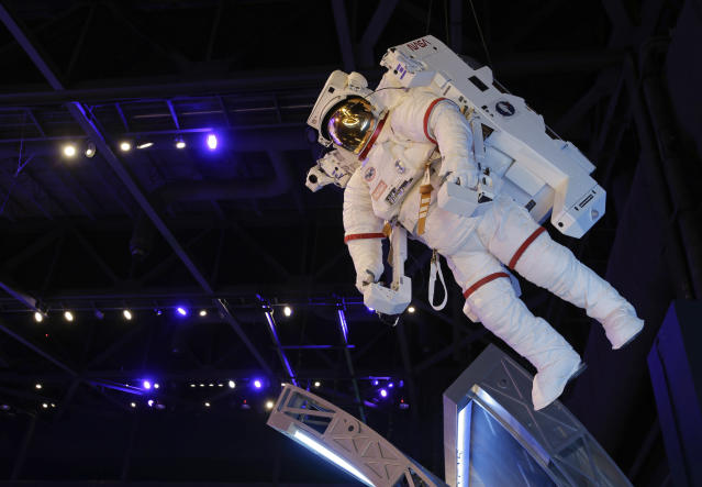 In this June 20, 2013 photo, an astronaut is mounted overhead in the space shuttle Atlantis attraction at the Kennedy Space Center Visitor Complex, in Cape Canaveral, Fla. The 900,000 square-foot facility centering around Atlantis will open to the public June 29. (AP Photo/John Raoux)