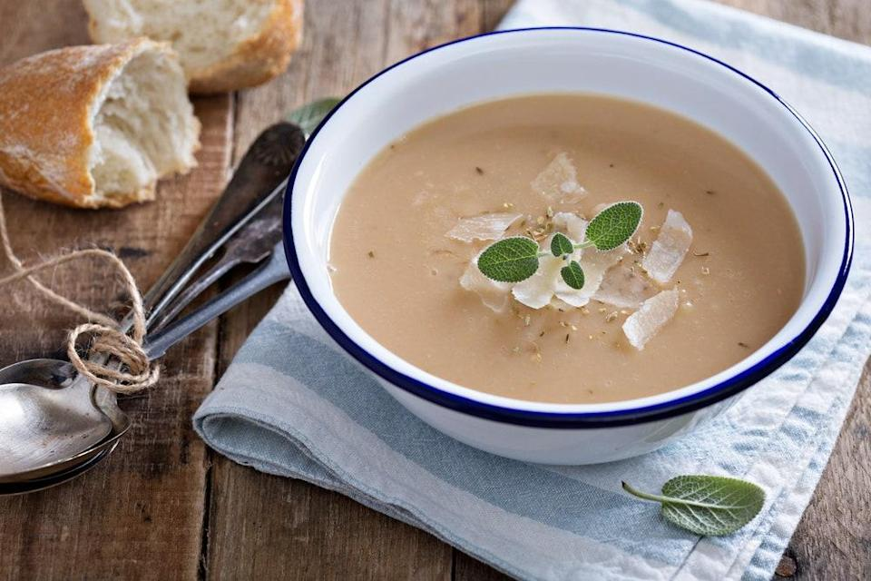 """A full 54 cloves of garlic go into this piquant, richly flavored, creamy soup. <a href=""""https://www.epicurious.com/recipes/food/views/roasted-garlic-soup-with-parmesan-cheese-100669?mbid=synd_yahoo_rss"""" rel=""""nofollow noopener"""" target=""""_blank"""" data-ylk=""""slk:See recipe."""" class=""""link rapid-noclick-resp"""">See recipe.</a>"""