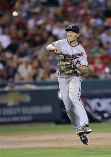 Minnesota Twins second baseman Doug Bernier throws to first base after fielding a ball hit by Los Angeles Angels' J.B. Shuck during the third inning of a baseball game on Monday, July 22, 2013, in Anaheim, Calif. Shuck was out at first. (AP Photo/Jae C. Hong)