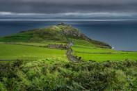 """<p>In the north-easternmost coastal tip of Ireland you'll find Ballycastle, a true Irish gem without the crowds. The perfect place to drive to on a road trip, it's home to lots of great restaurants. <a href=""""https://www.lonelyplanet.com/ireland/northern-ireland/ballycastle"""" rel=""""nofollow noopener"""" target=""""_blank"""" data-ylk=""""slk:Lonely Planet"""" class=""""link rapid-noclick-resp"""">Lonely Planet</a> recommends adding Kibane Castle to your must-visit list. </p><p><a class=""""link rapid-noclick-resp"""" href=""""https://go.redirectingat.com?id=127X1599956&url=https%3A%2F%2Fwww.booking.com%2Fholiday-homes%2Fcity%2Fgb%2Fballycastle-gb.en-gb.html&sref=https%3A%2F%2Fwww.cosmopolitan.com%2Fuk%2Fentertainment%2Ftravel%2Fg30397906%2Fbest-places-to-visit-uk%2F"""" rel=""""nofollow noopener"""" target=""""_blank"""" data-ylk=""""slk:BOOK NOW"""">BOOK NOW</a></p>"""
