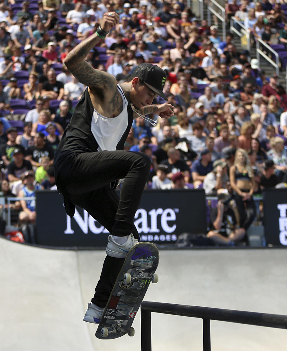 FILE - In this July 22, 2018, file photo, Nyjah Huston, the eventual gold medal winner, pulls off a trick in the men's skateboard street final at the X Games in Minneapolis. Huston is among five people prosecutors in Southern California have charged with organizing parties that were possible super spreader events at the height of the COVID-19 pandemic. (Alex Kormann/Star Tribune via AP, File)