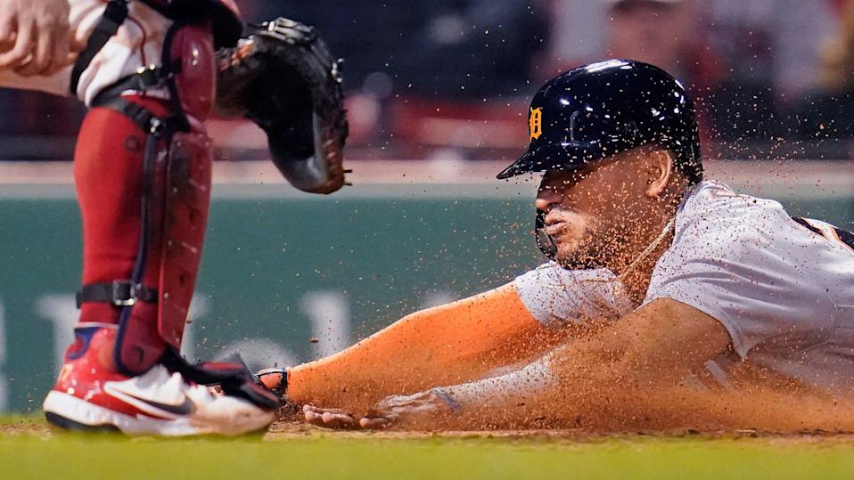 Detroit Tigers' Victor Reyes slides head first into home while scoring on an RBI double by Robbie Grossman during the fifth  at Fenway Park in Boston on Tuesday, May 4, 2021.