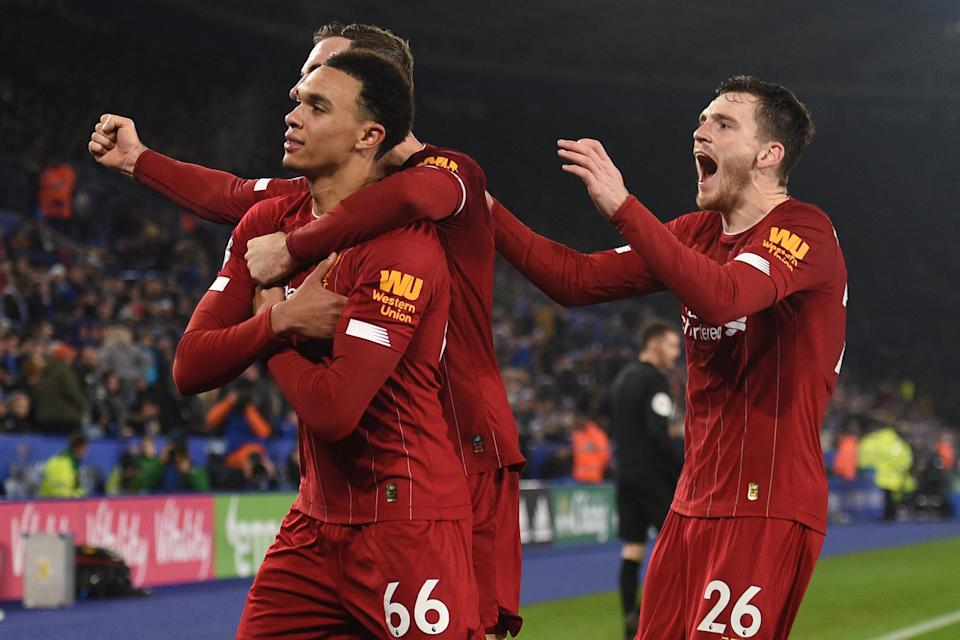Liverpool's English defender Trent Alexander-Arnold (L) celebrates with teammates after scoring their fourth goal during the English Premier League football match between Leicester City and Liverpool at King Power Stadium in Leicester, central England on December 26, 2019. (Photo by Oli SCARFF / AFP) / RESTRICTED TO EDITORIAL USE. No use with unauthorized audio, video, data, fixture lists, club/league logos or 'live' services. Online in-match use limited to 120 images. An additional 40 images may be used in extra time. No video emulation. Social media in-match use limited to 120 images. An additional 40 images may be used in extra time. No use in betting publications, games or single club/league/player publications. /  (Photo by OLI SCARFF/AFP via Getty Images)