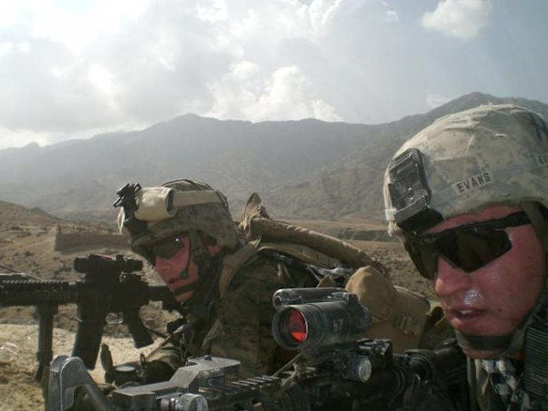 This 2009 photo provided by Lisa Freeman shows her son, Marine Capt. Matthew C. Freeman, left, in Afghanistan. Barely two weeks into his deployment, Freeman and a fire support team set out to do reconnaissance in the Shpee Valley when they came under almost immediate enemy attack and became pinned down. According to an official account, Freeman fought his way into a nearby building and up to the roof to get a better angle on the enemy position. Once atop, he spotted an insurgent with a rocket-propelled grenade and was firing at the man when he was shot in the back of the head. A comrade told Lisa Freeman her son was found with his finger on the trigger of his rifle; its magazine was nearly empty. (AP Photo/Lisa Freeman)