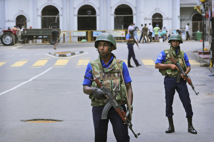 """Sri Lankan Naval soldiers stand guard outside St. Anthony's Church in Colombo, Sri Lanka, Monday, April 29, 2019. The Catholic Church in Sri Lanka says the government should crack down on Islamic extremists with more vigor """"as if on war footing"""" in the aftermath of the Easter bombings meanwhile the government has banned all kinds of face coverings that may conceal people's identities. The emergency law, which took effect Monday, prevents Muslim women from veiling their faces. (AP Photo/Manish Swarup)"""