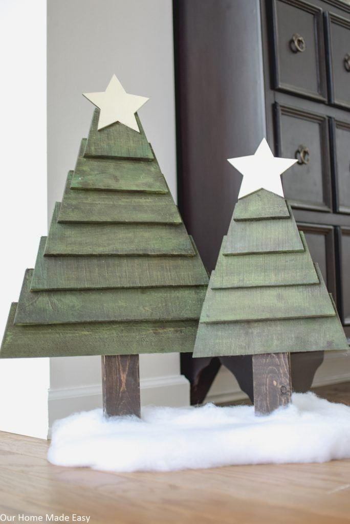 """<p>You can't go wrong with a classic design. That's why we love these traditional green trees—they'll fit into any home!</p><p><strong>Get the tutorial at <a href=""""https://www.ourhomemadeeasy.com/how-to-make-easy-pallet-christmas-trees/"""" rel=""""nofollow noopener"""" target=""""_blank"""" data-ylk=""""slk:Our Home Made Easy"""" class=""""link rapid-noclick-resp"""">Our Home Made Easy</a>.</strong></p><p><strong><a class=""""link rapid-noclick-resp"""" href=""""https://www.amazon.com/Luminos-LUM1106-Outdoor-Finish-Protector/dp/B07772MTM4/?tag=syn-yahoo-20&ascsubtag=%5Bartid%7C10050.g.23322271%5Bsrc%7Cyahoo-us"""" rel=""""nofollow noopener"""" target=""""_blank"""" data-ylk=""""slk:SHOP GREEN VARNISH"""">SHOP GREEN VARNISH</a><br></strong></p>"""