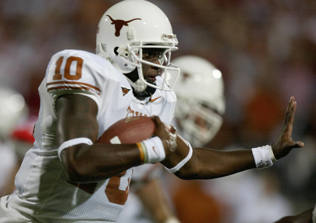 FILE - In this Sept. 10, 2005, file photo, Texas's quarterback Vince Young (10) runs against Ohio State in Columbus, Ohio. Heisman Trophy winner Carson Palmer and Vince Young will make their first appearances on the College Football Hall of Fame ballot. The National Football Foundation released Monday, June 4, 2018, the names of 76 players and six coaches from major college football who will be considered for the Hall of Fame this year. (AP Photo/Jay LaPrete, File)