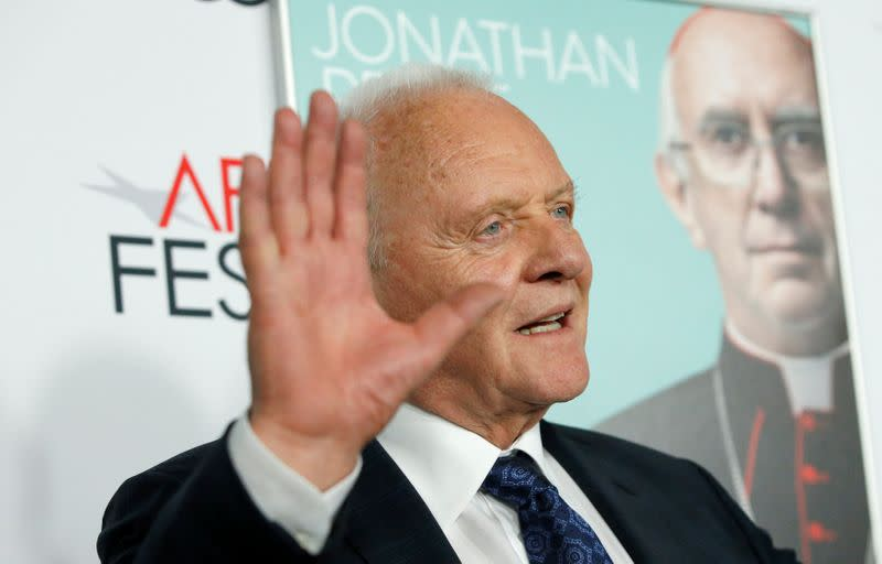 """Cast member Hopkins waves at a premiere for the film """"The Two Popes"""" during AFI Fest 2019 in Los Angeles"""