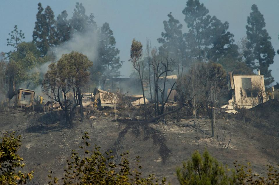 <p>A burnt-out home is seen in the aftermath of the fire (Picture: Yahoo Photo Staff) </p>