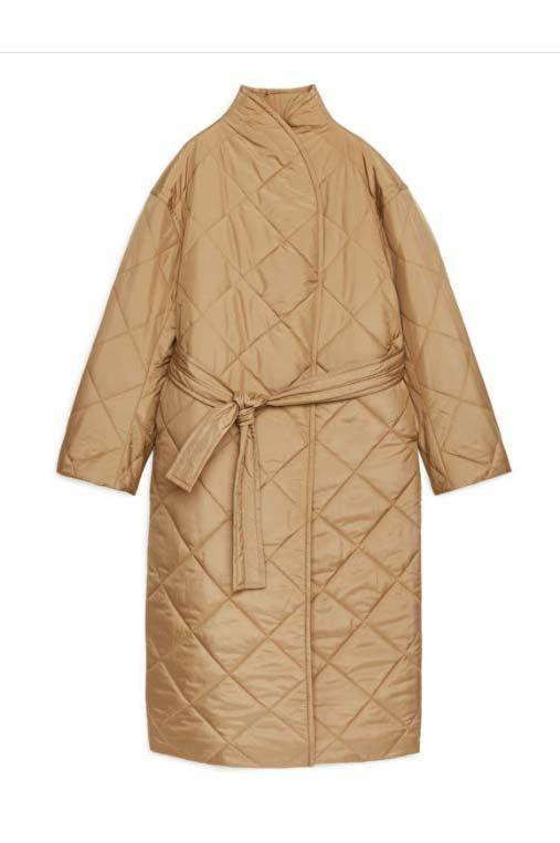 """<p><a class=""""link rapid-noclick-resp"""" href=""""https://www.arket.com/en_gbp/women/jackets-coats/product.oversized-quilted-coat-beige.0900521004.html"""" rel=""""nofollow noopener"""" target=""""_blank"""" data-ylk=""""slk:SHOP NOW"""">SHOP NOW</a></p><p>The one you weren't expecting to see in this edit: a quilted shell coat. But this style gained popularity in 2020 thanks to the change in lifestyle – when we were all swapping business meetings and commutes for long lunchtime walks. Comfort and warmth are key, so what's better than being shrouded in pillowy down and nestling into a generous funnel neck?</p><p>Oversized Quilted Coat, £150, Arket</p>"""
