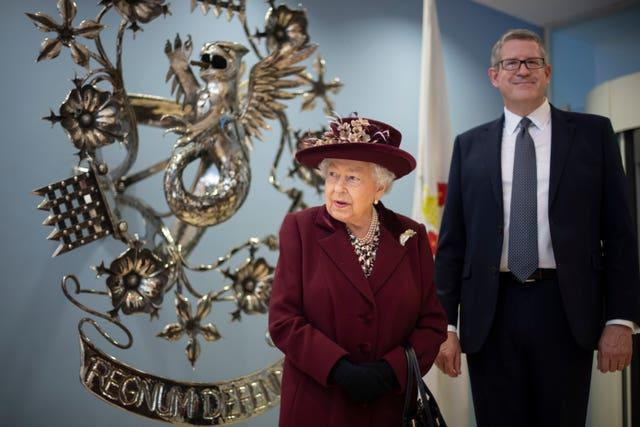 Baron Parker, pictured with the Queen during her MI5 visit, will begin his new role from April. Victoria Jones/PA Wire