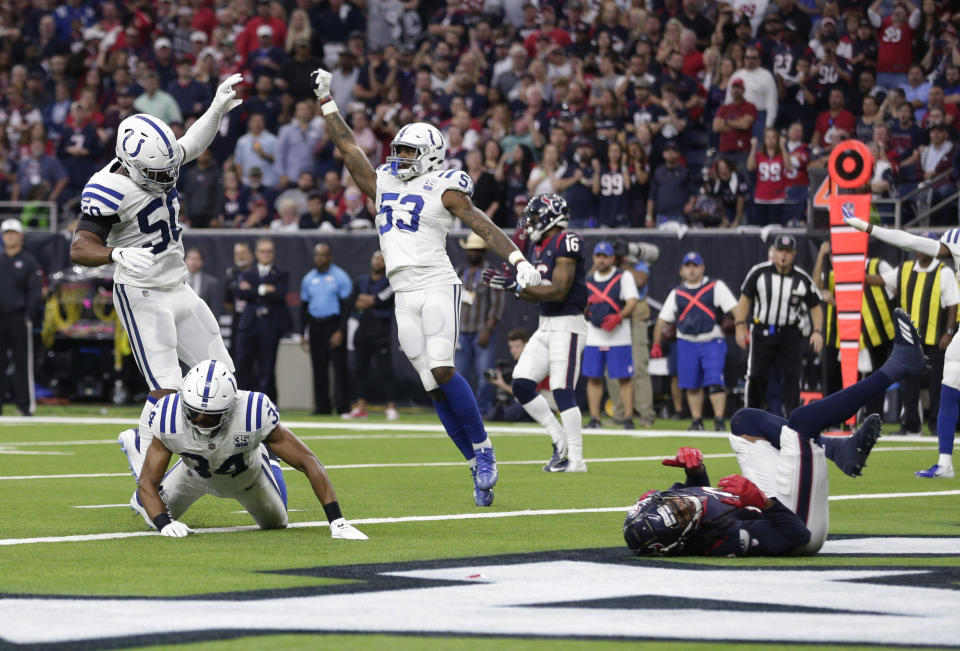 The Colts celebrate after a fourth-down pass to DeAndre Hopkins fell incomplete. (AP)