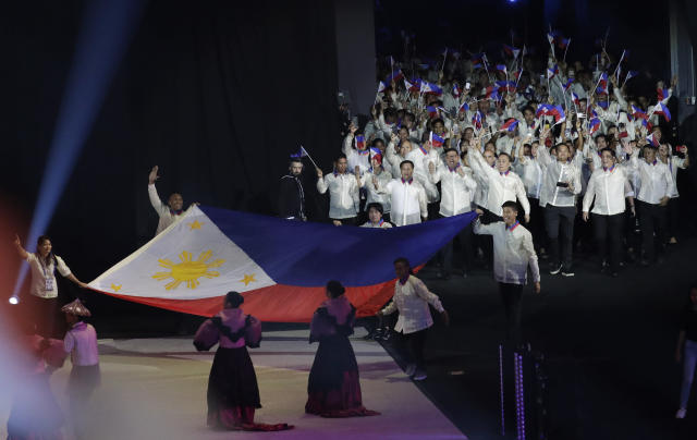 Philippine delegates cheer during the opening ceremony of the 30th South East Asian Games at the Philippine Arena, Bulacan province, northern Philippines on Saturday, Nov. 30, 2019. (AP Photo/Aaron Favila)