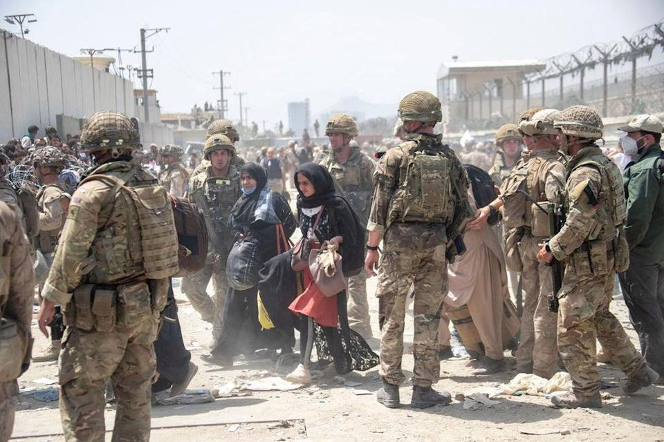 Members of the British and US military engage in the evacuation of people out of Kabul (AP)