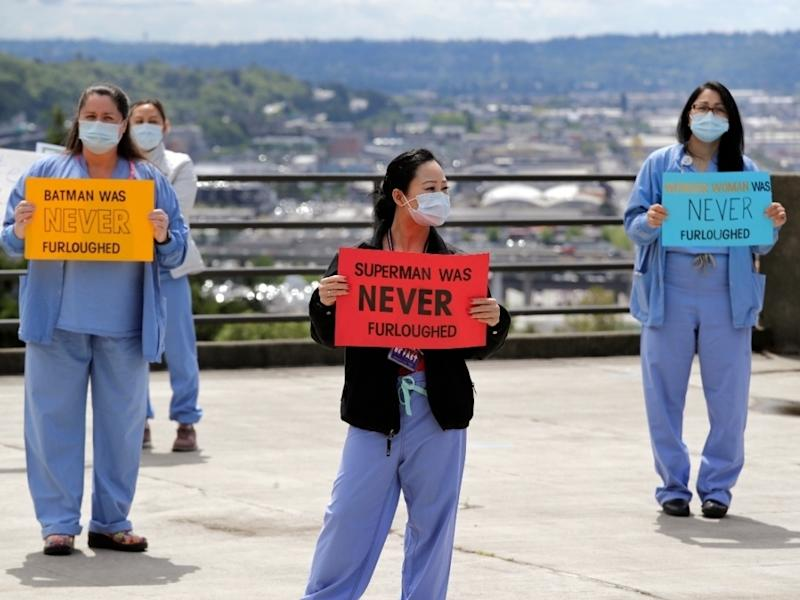On Thursday, health care workers stood in protest outside of UW Medicine's Harborview Medical Center asking management to do more to protect staff and patients.