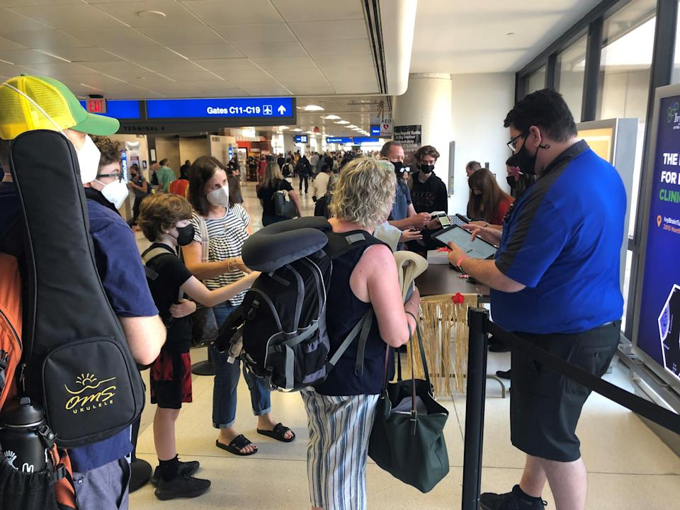 Hawaii-bound travelers at Phoenix Sky Harbor International Airport check in with Southwest Airlines' representatives as part of the airline's Hawaii pre-clear program.