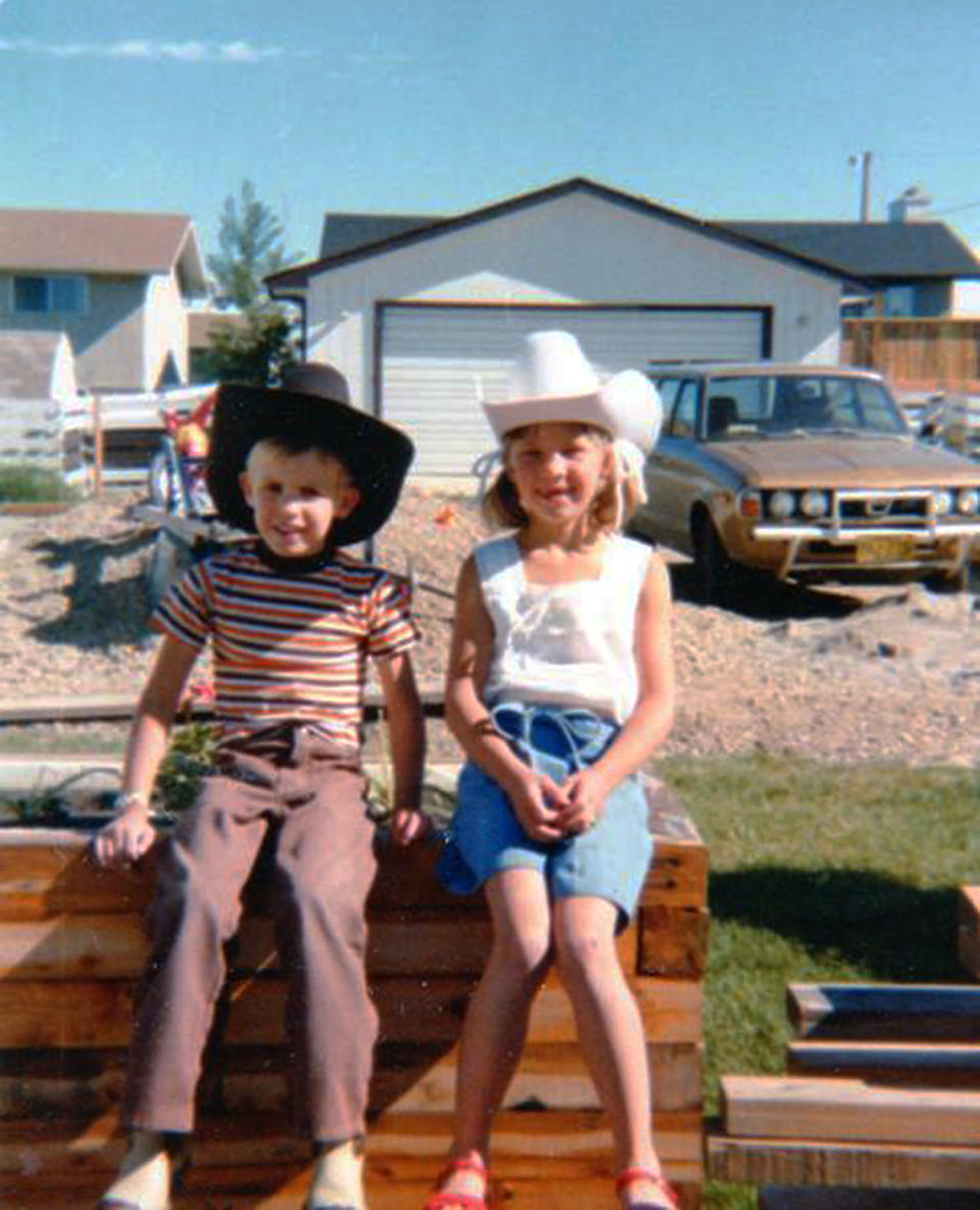 """This circa 1981 photo provided by Carol Tapanila shows her children wearing cowboy hats in Airdrie, Alberta, Canada for the Calgary Stampede event. After retiring from a job as an administrative assistant at an oil company in Calgary, Carol Tapanila, still a U.S. citizen, began putting $125 a month into a special savings account for her developmentally disabled son, left, matched by the Canadian government. But in 2012 she turned in her U.S. passport, renouncing citizenship to protect money saved for her retirement and her son. Tapanila, 70, has tried and failed to renounce U.S. citizenship on his behalf, saying officials told her such a decision must be made by the individual. """"I'm sorry that I've given my son this burden and I can do nothing about it ... I thought we had some rights to go wherever we wanted to go and some choices we could make in our lives. I thought that was democracy. Apparently, I've got it all wrong."""" (AP Photo/Carol Tapanila)"""