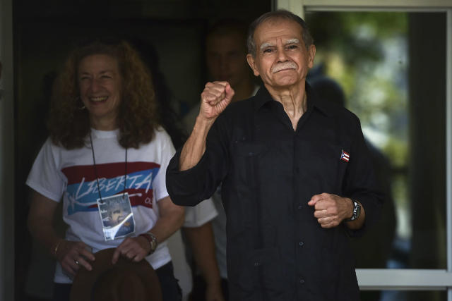 <p>Puerto Rican nationalist Oscar Lopez Rivera gestures as he is released from home confinement after 36 years in federal custody, in San Juan, Puerto Rico, Wednesday, May 17, 2017. Lopez was considered a top leader of Puerto Rican militant group that said it was responsible for more than 100 bombings in several U.S. cities and Puerto Rico during the 1970s and early 1980s. (Photo: Carlos Giusti/AP) </p>