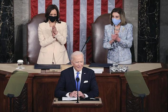 President Biden is joined by Vice President Kamala Harris, left, and Nancy Pelosi as addresses a joint session of Congress.