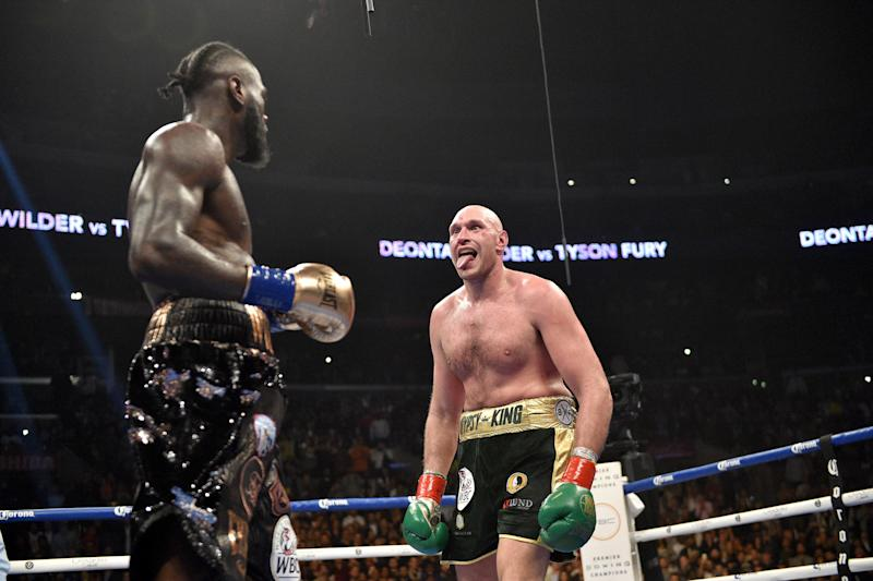Deontay Wilder prepares for Tyson Fury as he sticks out his tongue to mock him in the ring.