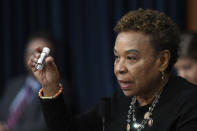 """FILE - In this March 11, 2020, file photo Rep. Barbara Lee, D-Calif., holds up a bottle of hand sanitizer as she questions Treasury Secretary Steven Mnuchin on Capitol Hill in Washington during a House Appropriations subcommittee hearing. Black lawmakers are urging President Joe Biden to donate 100 million more COVID-19 vaccines to Africa, where only 2% of the population is fully vaccinated and the death rate is the highest in the world."""" Reps. Barbara Lee and Karen Bass, California Democrats, wrote Biden on behalf of members of the influential Congressional Black Caucus. (AP Photo/Susan Walsh, File)"""