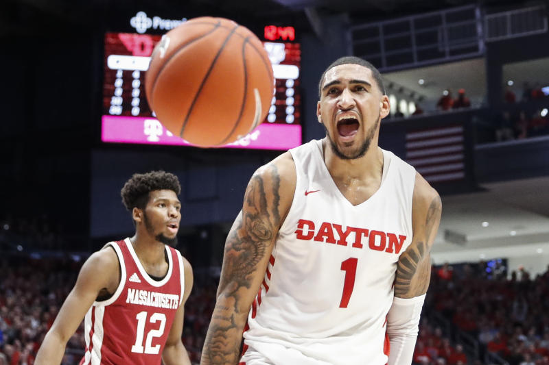 Dayton's Obi Toppin (1) reacts after dunking during the first half of an NCAA college basketball game against Massachusetts, Saturday, Jan. 11, 2020, in Dayton. (AP Photo/John Minchillo)