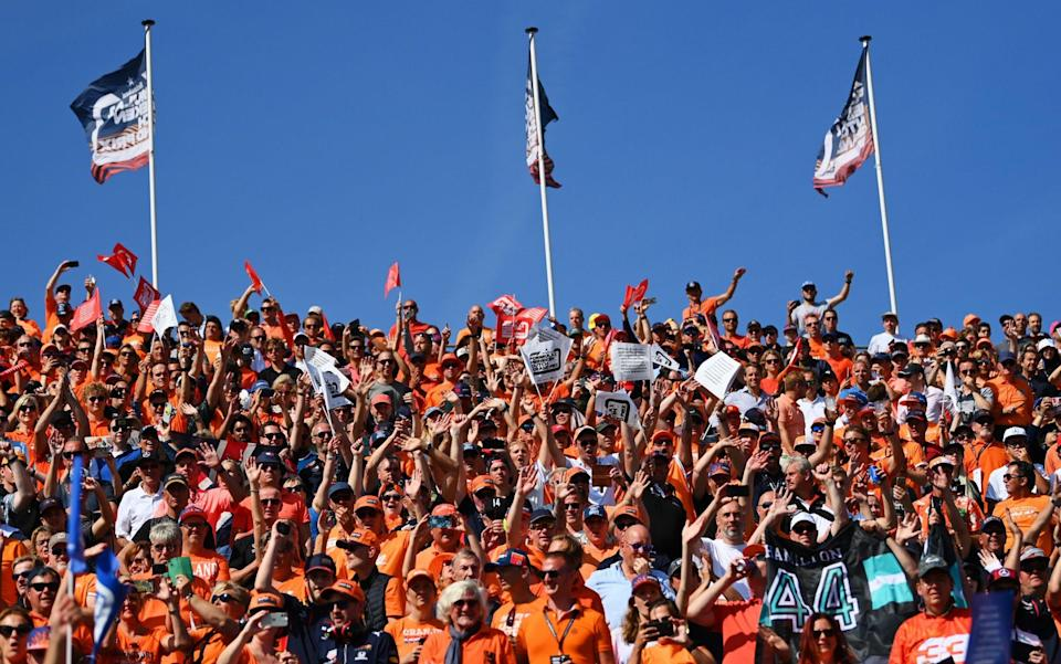 Max Verstappen of Netherlands and Red Bull Racing fans show their support during the F1 Grand Prix of The Netherlands at Circuit Zandvoort on September 05, 2021 in Zandvoort, Netherlands - Dan Mullan/Getty Images