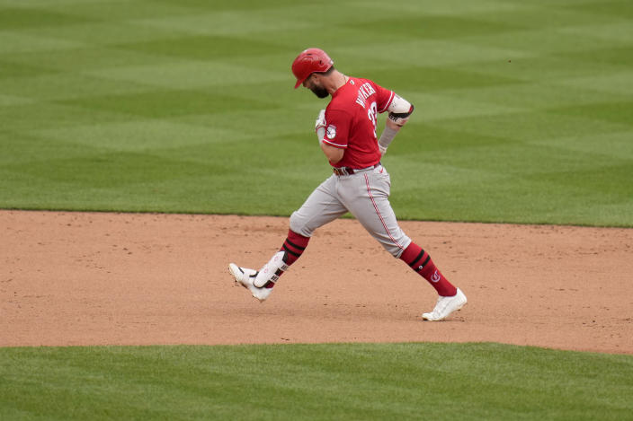 Cincinnati Reds' Jesse Winker celebrates as he rounds the bases after hitting a solo home run during the ninth inning of a baseball game against the St. Louis Cardinals Sunday, June 6, 2021, in St. Louis. (AP Photo/Jeff Roberson)