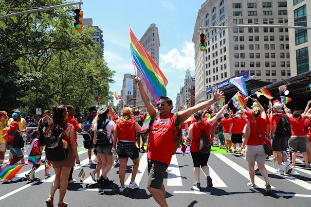 <p>People dance and wave rainbow flags during the N.Y.C. Pride Parade in New York on June 25, 2017. (Photo: Gordon Donovan/Yahoo News) </p>