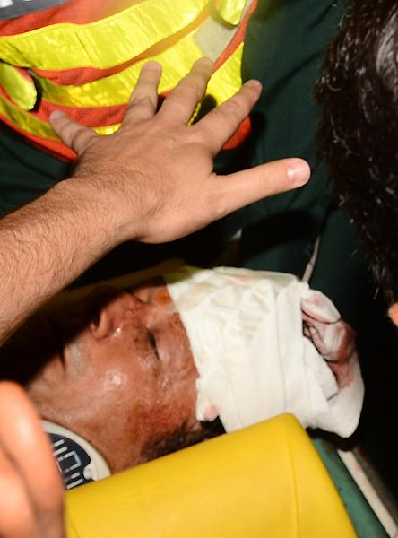 Rescue workers rush Imran Khan, Pakistan's cricket star-turned-politician to hospital in Lahore, Pakistan on Tuesday, May 7, 2013. One of Pakistan's most prominent politicians, former cricket star Imran Khan, fell from a stage at a political rally Tuesday, leaving him with two hairline skull fractures and uncertainty hanging over his ability to campaign ahead of Saturday's general election.(AP Photo/M.S. Shah)