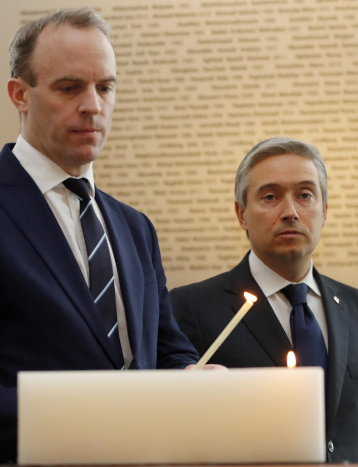 François-Philippe Champagne, Canada Minister of Foreign Affairs, right, UK's Secretary of ~State for Foreign Affair Dominic Raab light a candle in front of a plaque with the names of the victims of flight PS752, at the High Commission of Canada in London, Thursday, Jan. 16, 2020. The Foreign ministers gather in a meeting of the International Coordination and Response Group for the families of the victims of PS752 flight crashed shortly after taking off from the Iranian capital Tehran on Jan. 8, killing all 176 passengers and crew on board.(AP Photo/Frank Augstein)