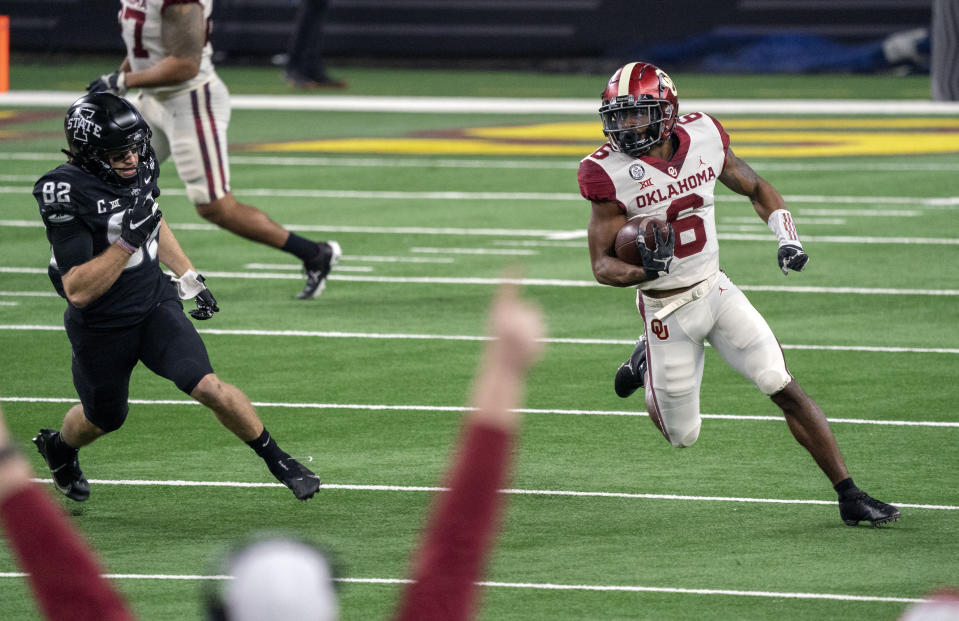 Oklahoma kick returner Tre Brown (6) turns the corner past Iowa State's Landen Akers (82) on a kickoff return during the first half of the the Big 12 Conference championship NCAA college football game, Saturday, Dec. 19, 2020, in Arlington, Texas. (AP Photo/Jeffrey McWhorter)