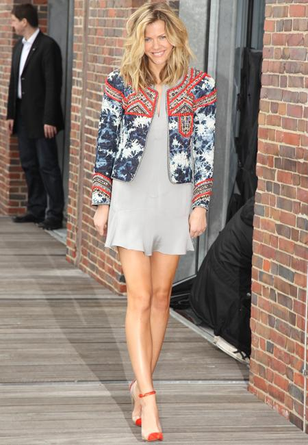 Celebrity fashion: Model-turned-actress Brooklyn Decker hit the Battleship promo trail this week and while in Germany she livened up a silk Theyskens Theory dress with a loud jacket by Isabel Marant. We're not sure the tie-dye affect on this ensemble is one we admire.