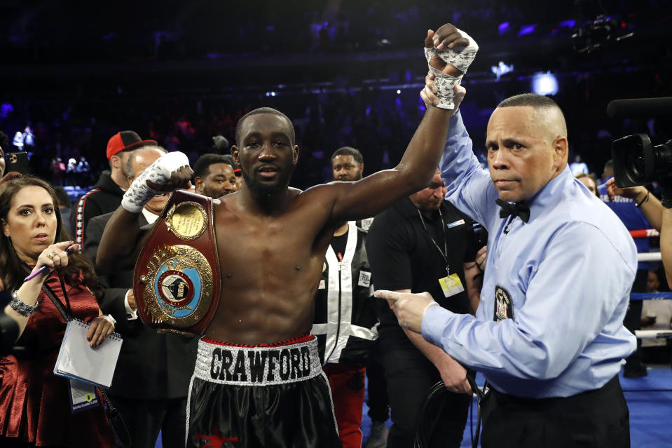 FILE - Terence Crawford has his hand raised in victory after defeating Lithuania's Egidijus Kavaliauskas by TKO in the ninth round of a WBO welterweight boxing match, Saturday, Dec. 14, 2019, in New York. Crawford is looking for a fight. The undefeated WBO welterweight champion has never fought less than twice in a calendar year as a professional. He faces the possibility of being idle all of 2020. (AP Photo/Michael Owens, File)