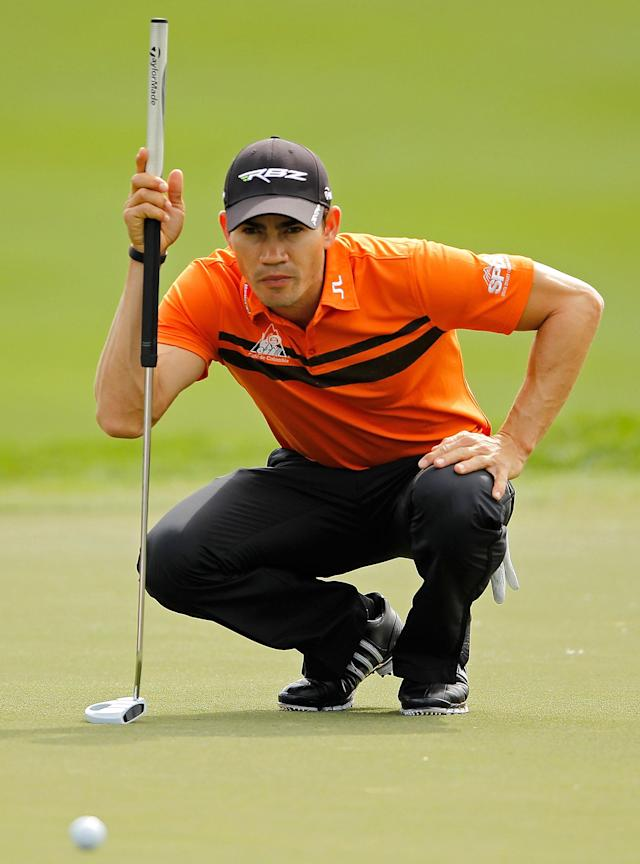 PALM BEACH GARDENS, FL - MARCH 01: Camilo Villegas of Colombia lines up a putt on the third hole during the first round of the Honda Classic at PGA National on March 1, 2012 in Palm Beach Gardens, Florida. (Photo by Mike Ehrmann/Getty Images)