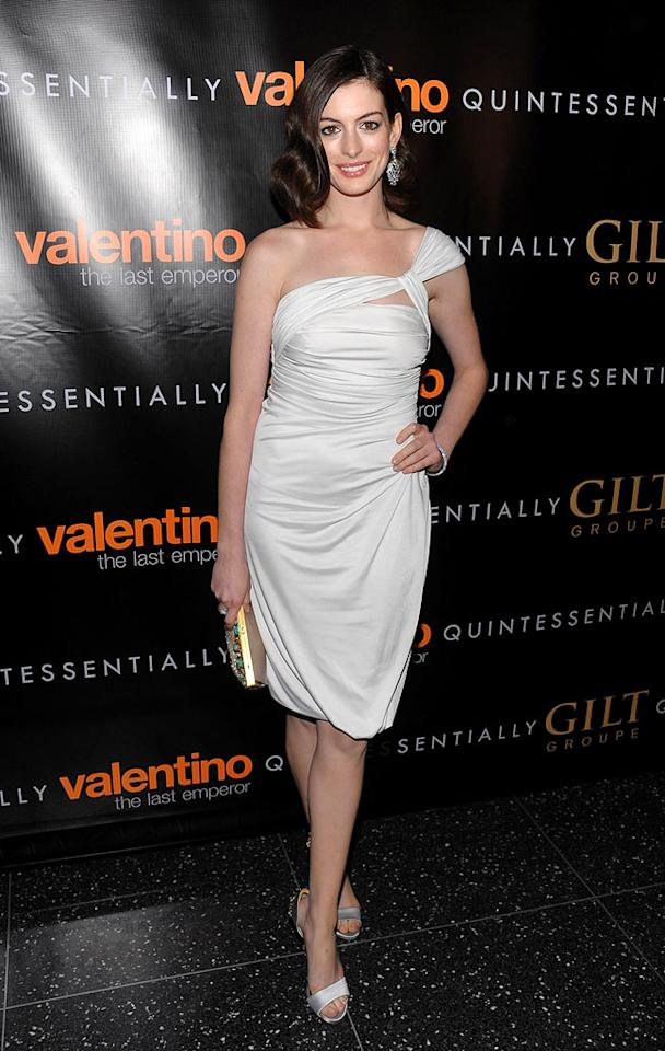 "Anne Hathaway arrived at New York's Museum of Modern Art for the premiere of ""Valentino: The Last Emperor"" in a white asymmetrical ruched dress, courtesy of the famous fashion designer. Dimitrios Kambouris/<a href=""http://www.wireimage.com"" target=""new"">WireImage.com</a> - March 17, 2009"